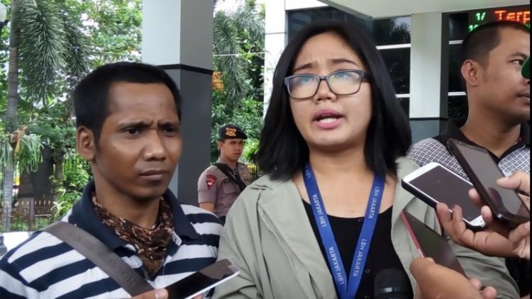 Rosikin (kiri), polisikan Direktur Keuangan Go-Jek
