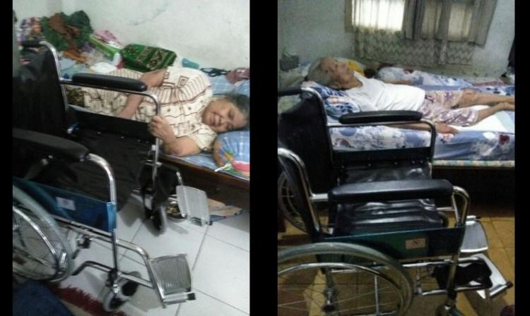 Ahok memberikan bantuan kursi roda kepada lansia