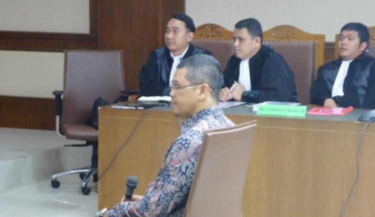 Yudi Widiana duduk di kursi terdakwa di Pengadilan Tipikor